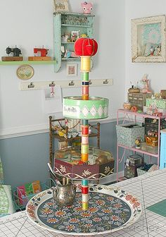 Rotating Craft Organizer From Old Tin Lazy Suzanne Thread Spools I Would Change It Up A Little But Using Tins Is Great Idea