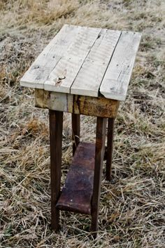 Occasional Table. 241/2″ x 14″. Crafted from reclaimed wood pallets and old mine tin. $60