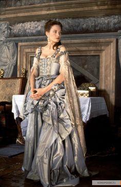 slate, brocade trim, slashed princess sleeves, front lacing over bodice