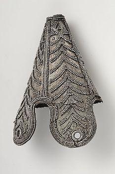 They totally make bead caps that look similar--look a Joanns silver hat-terminal ornament from Birka (Historiska Museet)