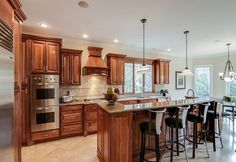 This magnificent masterpiece has incredible features to get design ideas from! The kitchen is filled with custom built-ins and wait until you see the master bathroom!!!