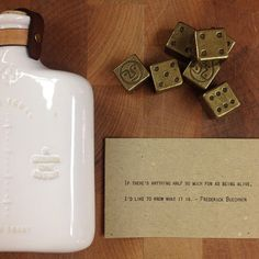 If there's anything half so much fun as being alive, I'd like to know what it is. - Fredrick Buechner Happy Friday, Folks! #fredrickbuechner #bealive Pictured here: White ceramic embossed flask with leather straps, brass stud and brass button. Wax cast brass dice. Quote from 365 Gathered Thoughts. All #MadeInAmerica. #coolgiftsforguys