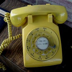 A vintage rotary phone in yellow.  I had this same phone in white when I was a teenager.  I would have loved this in my yellow bedroom.