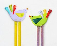 Fused glass isn't just for plates and jewelry. Check out Valerie Adams Glass. Funky birds and cats appear to be a versatile decoration. Perhaps plant sticks? Sun Catchers? Drink stirs? Whatev…