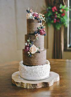 Chocolate ganache and ruffle wedding cake adorned with hand made sugar peonies, blackberries, hypericum berries and twigs.