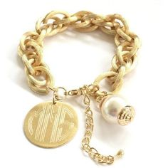 Personalized Bracelet with Pearl in Gold or Silver this is a customer favorite.  The fashion bracelet is high style with fashionable pearl and monogram disc.  Comes in a jewelry gift box. *Monograms are traditionally in First, Larger Last, Middle order.  We will engrave the letters exactly as you enter them.  Pendant -