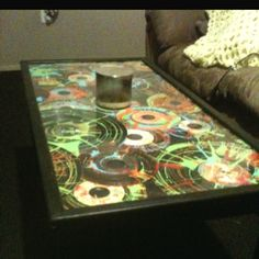 DIY Idea: Coffee Table decorated with Old Vinyl Records and Splashed Neon Paint.