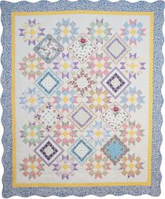 Hanky quilt.   Robert Kaufman  Fabrics is a wholesale converter  of quilting fabrics and textiles for manufacturers as well as a supplier to  the retail, quilting, home decor, bridal, uniform, and apparel industries.  Established in 1942.