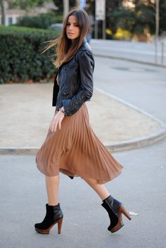 best combo ever: black leather & nude pleated skirt