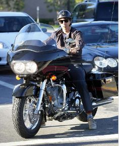 Anthony Kiedis of the Red Hot Chili Peppers on a motorcycle