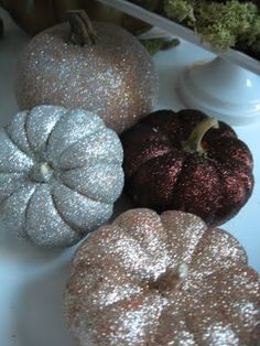 Glittered pumpkins by @JaimeeRose.  She takes those  fake pumpkins, glitters them, TAKES OFF THE FAKE STEM AND ADDS A REAL, DRIED PUMPKIN STEM.  Briiliant.