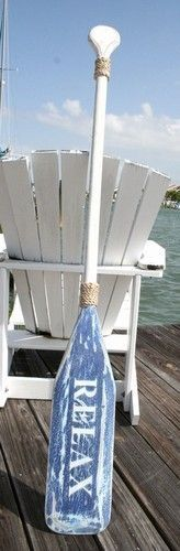 Wooden Distressed Paddle in white and blue with decorative rope accents and the word, RELAX. Distressed paddles can be used almost anywhere to add a subtle nautical touch to your décor. Hang horizonta