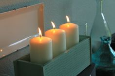 small wooden drawer (probably from old sewing machine cabinet) converted to candle holder