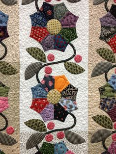 Close up of an appliqué quilt. Such patience! I always wonder how many hours - or years - goes into a quilt like this.