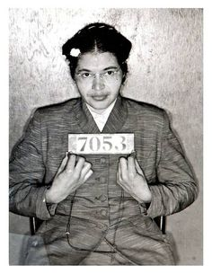 Rosa Parks being booked for staying in her seat on the bus.