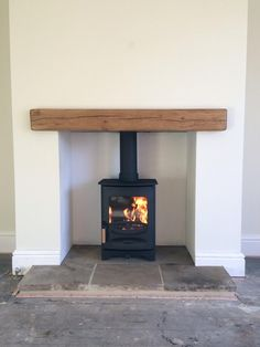 C-Four, oak fireplace beam, reclaimed Yorkshire stone hearth.Charnwood C-Four, oak fireplace beam, reclaimed Yorkshire stone hearth. Wood Burner Fireplace, Small Fireplace, Fireplace Hearth, Wood Mantle, Floating Fireplace, Wood Burner Stove, Cottage Fireplace, Fireplace Shelves, Fireplace Outdoor