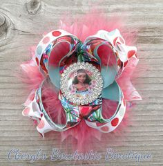 Moana inspired Twisted boutique Coral and Aqua blue bow by CherylsBowtasticBows