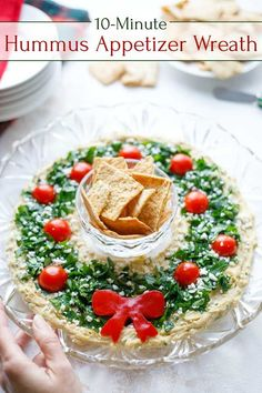 """Easy Christmas Appetizer """"Hummus Wreath"""" – Two Healthy Kitchens So impressive, but SO EASY! You'll wow 'em with this gorgeous appetizer dip … but you won't have to stress out to make it! Our """"Hummus Wreath"""" Christmas appetizer recipe comes together in min Healthy Christmas Recipes, Christmas Snacks, Xmas Food, Holiday Recipes, Christmas Parties, Christmas Apps, Christmas Potluck, Christmas Birthday, Simple Christmas"""