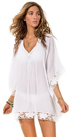 0e08b57cf6 The L Space Threads Offshore White Caftan from South Beach Swimsuits  Swimwear is a semi sheer coverup with wide sleeves and eylet detail.