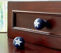 I love the Star Knobs on potterybarnkids.com. Adding them to a refinished farmhouse red dresser we just bought at Paper Street Antiques. Perfect piece to complete the vintage plane theme.