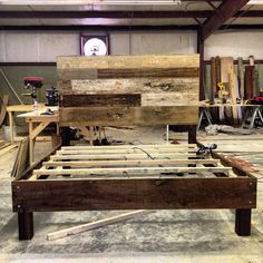 Reclaimed Wood Bed by TheDesignHome on Etsy, $1,200.00. Or just come get some of the wood in my backyard and make your own.