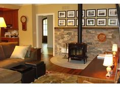 Living Room Ideas Log Burners woodstove with stacked stone behind. http://www.autumnglo