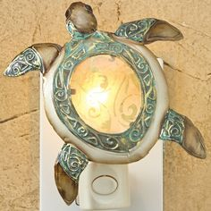 This Night Light features hand painted galvanized metal with capiz shell…