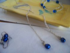 Lariat Necklace of Silver Seed Beads with Small Blue Beads by kaysjewelrydesign on Etsy