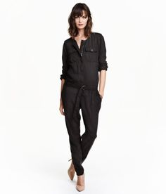 Check this out! CONSCIOUS. Jumpsuit in soft washed twill made from Tencel® lyocell. Concealed zip at front, shoulder tabs with button, and long sleeves with button at cuffs. Chest pockets with flap, side pockets, and back pockets with button. Elasticized seam at waist, belt with metal buckle, and tapered legs. - Visit hm.com to see more.
