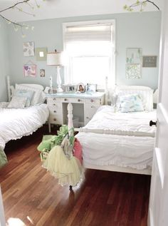 A shared room for two little girls