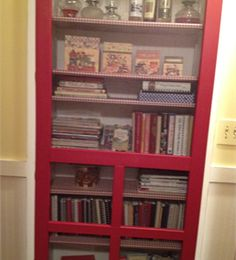 Cookbook cupboard. I like the concept. Could likely do something similar in the space below the open shelves in the new kitchen without cutting into drywall!