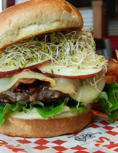 Spring 2016s Limited Time Offer Burger: Bison Burger w/garlic mayo, lettuce, tomato, creamy apple butter, alfalfa sprouts, bacon, Havarti cheese and apple slices.