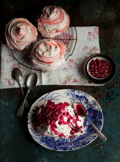 Pink swirl meringues with pomegranate syrup on DrizzleandDip.com #food #recipes #dessert