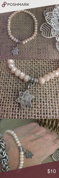 Pearl White Stretch Bracelet Pearl white glass Bead Stretch bracelet with a star charm. Add to your stack or start your stack today !  The charm is metal alloy with Rhodium plating.  I have several colors listed, bundle and save!  Z06 Jewelry Bracelets