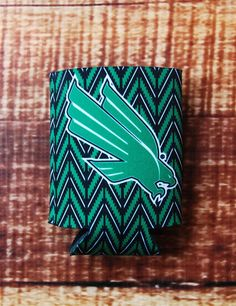 Looking for the perfect UNT tailgating koozie? Well here it is! This fun chevron koozie will keep your drink cold/warm all while flaunting your love for the University of North Texas! University Of North Texas, Mean Green, Chevron, Cold, Tailgating, Fun, Retail, Warm, Drinks