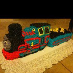 Thomas the Train Birthday cake with coal car. Wilton train cake pan for Thomas, bread pan for coal car & crushed Oreos for coal