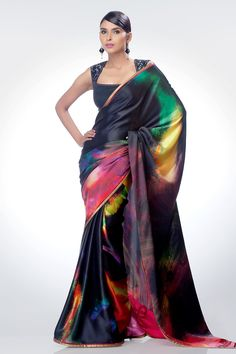 Channel your inner diva with this captivating creation. a mélange of vibrant colors, this dazzling drape will add oomph to your persona.
