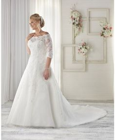 1614 - A-line gown with Alencon lace appliques. Bodice with off-the-shoulder neckline and three-quarter length, lace sleeves.  View our entire plus size wedding gown collection on our website.