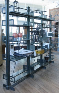 Vintage 1920s Bronze and Steel Adjustable Bookcase | From a unique collection of antique and modern bookcases at https://www.1stdibs.com/furniture/storage-case-pieces/bookcases/