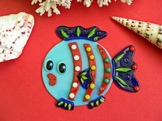 Handmade home decor made of Fused Glass. The Fish made of Fused Glass Art, multicolored,decor for hanging and gluing.