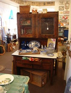 """Antique Possum Belly Cabinet and Hutch. One drawer has metal (rusted) and the other is wood. Porcelain top is in very good condition. The cabinet is 40"""" w x 25"""" d x 30"""" h and the hutch is 40"""" w x 12"""" d x 38"""" h. Overall height is 68"""". (Contents not included).  $260 Firm"""