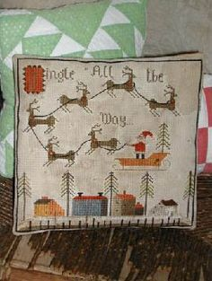 Notforgotten Farm Jingle All the Way - Cross Stitch Pattern. Model is stitched on 14ct tea-stained White Aida; stitch count is 144 x 144, design area is 10.25 x