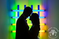 The Modern Art Museum of Fort Worth, wedding photo idea pose inspiration by Tracy Autem Photography. Must have photos. dress, bridal, bride, groom, colorful light artwork silhouette, classic, classy, formal  http://tracyautem.com