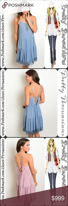 "Blue Tiered Ruffle Fringe Hem Lace Up Back Dress NWT Dusted Blue Fringe Hem Lace Up Back Dress  Available in sizes S, M, L Measurements taken from a small  Length: 37"" Bust: 34"" Waist: 32""  Rayon   Features  • fringe bottom hemline  • scooped neckline  • lace up back detailing • adjustable spaghetti straps  • soft, breathable material  • relaxed, easy fit  * Also available in mauve pink  Bundle discounts available  No pp or trades  Item # 1/1-7220390BFHD Pretty Persuasions Dresses"