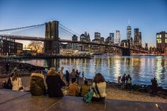 Enjoy the sunset in Dumbo Brooklyn by Julienne Schaer | via newyorkcityfeelings.com - The Best Photos and Videos of New York City including the Statue of Liberty Brooklyn Bridge Central Park Empire State Building Chrysler Building and other popular New York places and attractions.