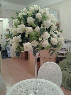 Stunning ivory martini vase arrangement.