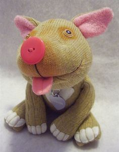 Babette by sockdogs, via Flickr - This is just the Flickr pic, but it looks like she makes custom sock dogs. I love the tongue & big pink button nose!