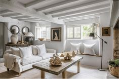 This beamed cottage has been modernised with new floors and a fresh neutral colour palette. To add more modernity to the space, they have also painted the beams to avoid the heavy-ceilinged feel you can sometimes get in an old cottage. Image: Anton & K. Cottage Living Rooms, Living Room Decor, Cottage Homes, Salons Cottage, White Beams, White Wood, Dark Wood, Rustic Home Interiors, French Interiors