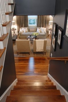 Rich wood floors, dark paint, white trim, makes for a very cozy look that I love.