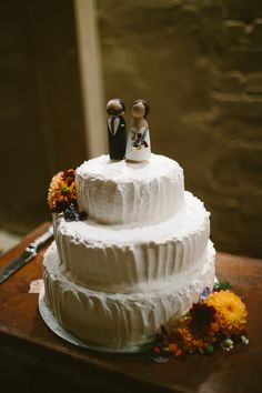 Homemade wedding cake with wooden cake toppers.  http://www.epiclovephotography.com/